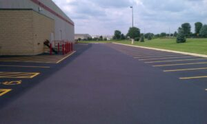 Asphalt Pavement seal application prevents years of water damage